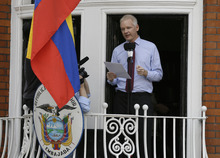 Julian Assange, founder of WikiLeaks makes a statement from a balcony of the Equador Embassy in London, Sunday, Aug. 19, 2012. Assange called on United States President Barack Obama to end a
