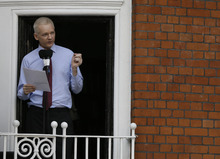 Julian Assange, founder of WikiLeaks makes a statement from a balcony of the Equador Embassy in London, Sunday, Aug. 19, 2012.  Assange called on United States President Barack Obama to 'end a