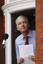 WikiLeaks founder Julian Assange looks up as he retreats from the window of Ecuadorian Embassy in central London after making a statement to the media and supporters outside, Sunday, Aug. 19, 2012. Assange called on United States President Barack Obama to end a