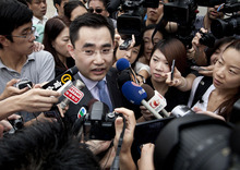 Lawyer He Zhengsheng of British Neil Heywood speaks to the media upon arrival at the Hefei City Intermediate People's Court for the verdict trial of Gu Kailai, wife of ousted Chinese politician Bo Xilai, Monday, Aug. 20, 2012 in Hefei, Anhui Province, China.  The fallen Chinese politician's wife who confessed to killing Heywood is due to hear the verdict Monday in her murder trial, and Communist Party leaders may have decided against a death penalty for fear it could incite public sympathy for her.  (AP Photo/Andy Wong)