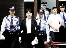 This Aug. 9, 2012 video image taken from CCTV shows Gu Kailai, second left, the wife of disgraced politician Bo Xilai, being taken to the trial at the Intermediate People's Court in the eastern Chinese city of Hefei. The murder of a British businessman by the wife of the ousted Chinese politician was supposed to be an open-and-shut case, by the government's account. The victim threatened the life of Gu's son. Gu poisoned the Briton, was caught and confessed. End of story. A man in white shirt at right is Zhang Xiaojun, family aide of Gu. (AP Photo/CCTV via APTN) CHINA OUT, TV OUT