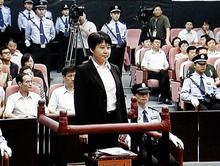 FILE - In this Aug. 9, 2012 file video image taken from CCTV, Gu Kailai, center, the wife of disgraced politician Bo Xilai, stands during her trial in the Hefei Intermediate People's Court in Hefei in eastern China's Anhui province. The murder of a British businessman by Gu, the wife of an ousted Chinese politician, was supposed to be an open-and-shut case, by the government's account, but the trial proceedings, and official statements about them, have failed to clarify glaring omissions in the case. (AP Photo/CCTV via APTN, File) CHINA OUT, TV OUT