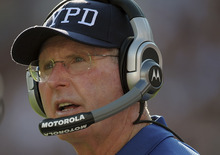 New York Giants head coach Tom Coughlin wearing an New York Police Department cap watches the action on the field during the first half of an NFL football game against the Washington Redskins in Landover, Md., on Sunday, Sept. 11, 2011.  (AP Photo/Cliff Owen)