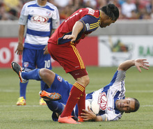 Rick Egan  | The Salt Lake Tribune   Real Salt Lake's Fabian Espindola (7) collides with Daniel Hernandez (2)F.C. Dallas, in MLS soccer action, at Rio Tinto Stadium, Saturday, August 18, 2012.