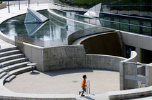 Kim Raff  |  The Salt Lake Tribune A child runs through the amphitheater in Library Square in Salt Lake City. City officials recently visited Vancouver on the British Columbia coast to gain insight into urban vitality.