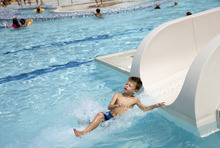Kim Raff    The Salt Lake Tribune Asher Moody goes down the water slide at the Suncrest Community Pool in Draper, Utah on August 15, 2012. Asher's parents decided it would be best for him to start kindergarten at Summit Academy this month -- after he turned 6 on Aug. 1 -- rather than a year ago, when he'd barely turned 5 by the first day of school.