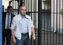 Garry Kasparov, front, a Russian opposition leader and former world chess champion leaves a police station after testifying in Moscow, Russia, Monday, Aug. 20, 2012. (AP Photo/Misha Japaridze)