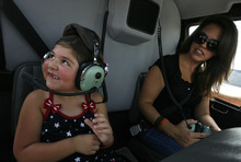Scott Sommerdorf  |  The Salt Lake Tribune              Agent Jared Francom's daughter Samantha, left, and his widow, Erin, get settled in the helicopter donated by Utah Helicopter that would take them along the ride route to the state Capitol, Sunday, August 19, 2012.