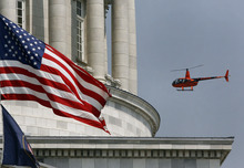 Scott Sommerdorf  |  The Salt Lake Tribune              The helicopter transporting Agent Francom's widow, Erin, and his daughters, Samantha and Hailey, arrives at the state Capitol, Sunday, August 19, 2012.