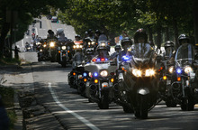 Scott Sommerdorf  |  The Salt Lake Tribune              The front of the convoy of over 4,000 riders heads up State Street a block or so away from the state Capitol for a ceremony featuring a special tribute for fallen officers Agent Jared Francom and Trooper Aaron Beesley, Sunday, August 19, 2012.