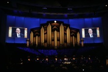 Kim Raff  |  The Salt Lake Tribune Photographs of LDS President Thomas S. Monson are shown on screens during