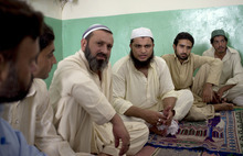 Cleric Hafiz Mohammad Zubair, third from right, meets with residents in a suburb of Islamabad, Pakistan at a local mosque on Monday, Aug. 20, 2012 regarding an alleged blasphemy by a Christian girl. Pakistani authorities arrested a Christian girl and are investigating whether she violated the country's strict blasphemy laws after furious neighbors surrounded her house and demanded police take action, a police officer said Monday. (AP Photo/B.K. Bangash)