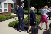 Republican presidential candidate, former Massachusetts Gov. Mitt Romney leaves the Church of Jesus Christ of Latter-day Saints after services on Sunday, Aug. 19, 2012 in Wolfeboro, N.H.  (AP Photo/Evan Vucci)