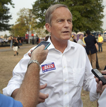 In this Thursday, Aug. 16, 2012 photograph, Rep. Todd Akin, R-Mo., talks with reporters while attending the Governor's Ham Breakfast at the Missouri State Fair in Sedalia, Mo. Akin was keeping a low profile, Monday, Aug. 20, 2012, a day after a TV interview in which he said that women's bodies can prevent pregnancies in