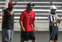 Scott Sommerdorf  |  The Salt Lake Tribune              Morgan Scalley yells at his safties as they defend a play at Utah football practice, Saturday, August 18, 2012.