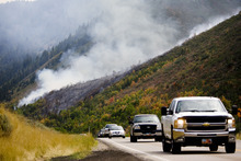 Kim Raff | The Salt Lake Tribune People travel west on Highway 40 as firefighters battle a new wildfire off the highway outside of Heber in Wasatch County,Utah on August 19, 2012.