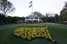 This April 5, 2006 file photo shows bright yellow flowers in the shape of the United States adorn the lawn at the clubhouse during practice for the 2006 Masters golf tournament at the Augusta National Golf Club in Augusta, Ga. For the first time in it's 80-year history, Augusta National Golf Club has female members. The home of the Masters, under increasing criticism the last decade because of its all-male membership, invited former Secretary of State Condoleeza Rice and South Carolina financier Darla Moore to become the first women in green jackets when the club opens for a new season in October. (AP Photo/David J. Phillip, File)