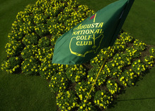 This April 7, 2002 file photo shows The Augusta National Golf Club flag framed by yellow flowers planted in the shape of the United States on display in front of the clubhouse in Augusta, Ga. For the first time in it's 80-year history, Augusta National Golf Club has female members. The home of the Masters, under increasing criticism the last decade because of its all-male membership, invited former Secretary of State Condoleeza Rice and South Carolina financier Darla Moore to become the first women in green jackets when the club opens for a new season in October.  (AP Photo/Dave Martin, FIle)