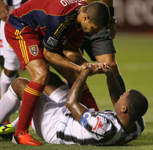 Steve Griffin | The Salt Lake Tribune   Real Salt Lake's Alvaro Saborio helps up Tauro FC's Lucho Moreno during a Champions League game against Tauro FC at Rio Tinto Stadium in Sandy on Tuesday, Aug. 21, 2012.