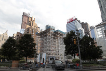 Scaffolding surrounds the statue of Christopher Columbus, Tuesday, Aug. 21, 2012 in New York's Columbus circle. Japanese artist Tatzu Nishi is constructing
