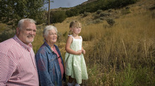 Paul Fraughton |  The Salt Lake Tribune Three generations of real estate developer M. Kenneth White's descendents -- grandson Kerry Jackson, daughter Joyce Jackson and great-great granddaughter Annie Jackson, 3, look over land   along the foothills of Grandeur Peak that the White family has donated to Salt Lake County to extend the Bonneville Shoreline Trail.