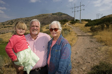 Paul Fraughton |  The Salt Lake Tribune Holding his granddaughter Annie, Kevin Jackson stands with his mother, Joyce Jackson, at the trailhead for the Bonneville Shoreline Trail near the mouth of Parleys Canyon. The White family donated 18 acres along the foothills of Grandeur Peak to the county, which will extend the Bonneville Shoreline Trail.