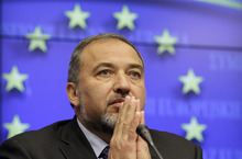 FILE - In this Tuesday, Feb. 22, 2011 file photo, Israel's Foreign minister Avigdor Lieberman attends a media briefing at the ned of an EU-Israel Association Council at the European Council building in Brussels. Lieberman sent a letter to international Mideast peace mediators calling Abbas an