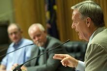 Chris Detrick  |  The Salt Lake Tribune Bill Barron and Shaun McCausland listen as Scott Howell speaks in a Senate debate at Bountiful City Council Chambers Tuesday August 21, 2012. `