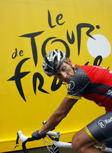 In this July 9, 2010, file photo, Lance Armstrong prepares to take the start of the sixth stage of the Tour de France cycling race over 227.5 kilometers (141.4 miles) with a start in Montargis and finish in Gueugnon, France. Armstrong said on Thursday, Aug. 23, 2012, that he is finished fighting charges from the United States Anti-Doping Agency that he used performance-enhancing drugs during his unprecedented cycling career, a decision that could put his string of seven Tour de France titles in jeopardy. (AP Photo/Christophe Ena, File)