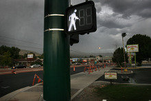 Scott Sommerdorf  |  The Salt Lake Tribune              Pedestrian signs on North Temple, Friday, August 11, 2012.  Barbara Brown, an environmental psychologist with the University of Utah Department of Family and Consumer Studies, is leading research to determine whether walkable neighborhoods impact health. She will rig hundreds of participants who live near North Temple with devices that will monitor their movements now and a year later after North Temple project has been completed and the place becomes a pedestrian's paradise