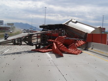 A late Thursday morning accident involving this gravel-hauling truck closed down lanes of Interstate 15 near Orem. (UHP photo)