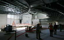 Steve Griffin | The Salt Lake Tribune Salt Lake County and West Valley City officials get a tour of the new Granger High School construction site Wednesday, Aug. 22, 2012. Here, guests get a view of the 1,500-seat auditorium. Last year, students and community members celebrated the completion of Granger's football stadium, complete with bright red seats and a field adorned with a giant