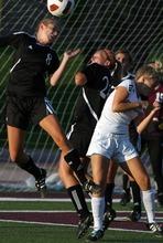 Kim Raff | The Salt Lake Tribune (left) Murray player Iasia Beh heads the ball in the air during a girls soccer game against Jordan at Jordan High School in Sandy, Utah on August 23, 2012.