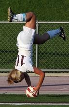 Kim Raff | The Salt Lake Tribune Jordan High School player Madi Hill does a flip throw in during a game against Murray at Jordan High School in Sandy, Utah on August 23, 2012.