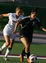 Kim Raff | The Salt Lake Tribune Jordan High School player (left) Tori Smith and Murray player Breanna Archuleta battle for the ball during a girls soccer game at Jordan High School in Sandy, Utah on August 23, 2012.