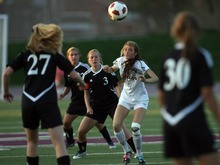 Kim Raff | The Salt Lake Tribune Jordan High School player (right) Jacqueline Williams and Murray player Victoria Riches battle for a ball in the air during a girls soccer game at Jordan High School in Sandy, Utah on August 23, 2012.