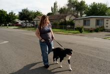 Trent Nelson  |  The Salt Lake Tribune Lisa Anderson walks her dog Swift near her home in West Valley City, Utah Friday, August 10, 2012. Anderson had weight-loss surgery last year to try to get pregnant.