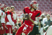 Chris Detrick  |  The Salt Lake Tribune Utah Utes quarterback Travis Wilson (7) looks to pass the ball during a practice at Rice-Eccles Stadium Tuesday April 17, 2012.