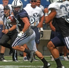 Rick Egan  | The Salt Lake Tribune   BYU running back JD Falslev runs the ball during the football scrimmage at LaVell Edwards Stadium, Thursday, August 16, 2012.