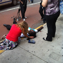 This photo posted to an Instagram account belonging to a person identified as mr_mookie, an eyewitness at the scene, shows a victim of a shooting being tended to by pedestrians outside the Empire State Building in New York, Friday, Aug. 24, 2012. The identity or condition of the victim was not immediately known. Law enforcement officials in New York City say at least four people have been shot outside the Empire State Building in violence that stemmed from a workplace dispute, and that the gunman has been killed by police. The shooting happened at about 9 a.m. Friday at 34th Street and Fifth Avenue. (AP Photo/mr_mookie via Instagram)