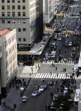 Police surround a sheet covered body, lowser left, on a Fifth Avenue sidewalk as they investigate a multiple shooting outside the Empire State Building, Friday, Aug. 24, 2012, in New York. At least four people were shot on Friday morning and the gunman was dead, New York City officials said. A witness said the gunman was firing indiscriminately. Police said as many as 10 people were injured, but it is unclear how many were hit by bullets. A law enforcement official said the shooting was related to a workplace dispute. The official spoke on condition of anonymity because the investigation was ongoing.  (AP Photo/ Louis Lanzano)