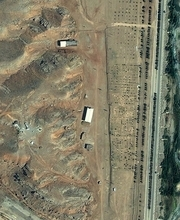 In this satellite image supplied Friday Aug. 24, 2012, by the Institute for Science and International Security (ISIS),  showing what they say are the results of extensive alterations undertaken at a suspected high explosives testing site, including the demolition of two buildings and major earth displacement activities, on July 25, 2012, at the Parchin military complex southeast of Tehran, Iran. Other photos taken at a later date appear to show the same buildings, seen here at centre and top, but shrouded with a pink tarp to stop the U.N nuclear agency from monitoring Tehran's efforts to sanitize the site which they suspect was used for secret work on atomic weapons, diplomats told The Associated Press on Friday Aug. 24, 2012. The information on the shrouding of the building came from two diplomats who demanded anonymity because they were not authorized to discuss the confidential satellite images. (AP Photo/ISIS)
