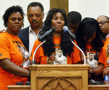 Alice Williams, mother of Darrell Williams, who was convicted last month of groping two women and reaching inside their pants without their consent at a house party, speaks during a rally at Mt. Zion Baptist Church in Stillwater, Okla., Thursday, Aug. 23, 2012. Surrounding Alice Williams are, from left, Mildred Williams, aunt of Darrell Williams; the Rev. Jesse Jackson; Pierre WIlliams, brother of Darrell Williams; Alicia Williams, sister of Darrell Williams; and Bishop Tavis Grant, National Field Director of the Rainbow/PUSH Coalition. (AP Photo/The Oklahoman, Nate Billings) TABLOIDS OUT
