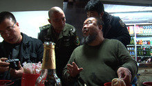 Chinese artist and activist Ai Weiwei (center) talks to a Chengdu policeman who's suspicious of his visit to the Sichuan province city, in a scene from the documentary