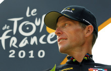 FILE - In this July 25, 2010, file photo,  Lance Armstrong looks back on the podium after the 20th and last stage of the Tour de France cycling race in Paris, France. A federal judge dismissed Armstrong's lawsuit aimed at preventing the U.S. Anti-Doping Agency from moving ahead with charges that he used performance-enhancing drugs throughout much of his long career.