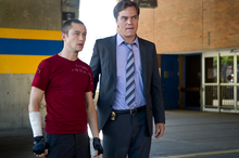 This film image released by Columbia Pictures shows Joseph Gordon-Levitt, left, and Michael Shannon in a scene from