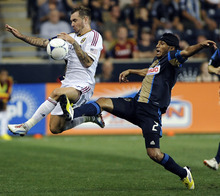 Real Salt Lake's Jonny Steele, right, of Northern Ireland, takes the ball away from Philadelphia Union's Carlos Valdes (2), of Colombia, during the second half of an MLS soccer game on Friday, Aug. 24, 2012, in Chester, Pa. The game ended in a 0-0 tie. (AP Photo/Michael Perez)