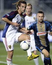 Real Salt Lake's Kyle Beckerman, left, recieves a pass in front Philadelphia Union's Jack Mclnerney during the first half of an MLS soccer game on Friday, Aug. 24, 2012, in Chester, Pa.  (AP Photo/Michael Perez)