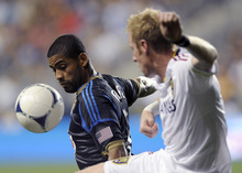 Philadelphia Union's Gabriel Gomez, left, of Panama, receives a pass in front of Real Salt Lake's Nat Borchers during the first half of an MLS soccer game on Friday, Aug. 24, 2012, in Chester, Pa.  (AP Photo/Michael Perez)