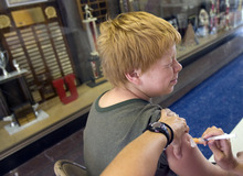 Kim Raff  |  The Salt Lake Tribune Phillip Young receives a vaccination during an immunization clinic at Brockbank Junior High School in Magna, Utah on August 15, 2012. The school district holds the clinics to get children caught up on their vaccinations in advance of the school year.